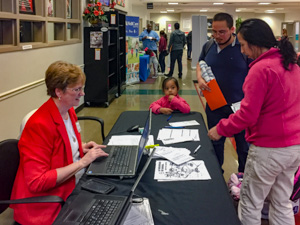 Superintendent Judy Gilreath helps register new prekindergarten students.